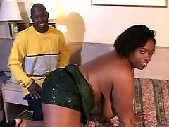 Dark skinned babe goes wild on sofa